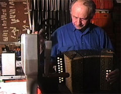 jonas mekas playing the accordian